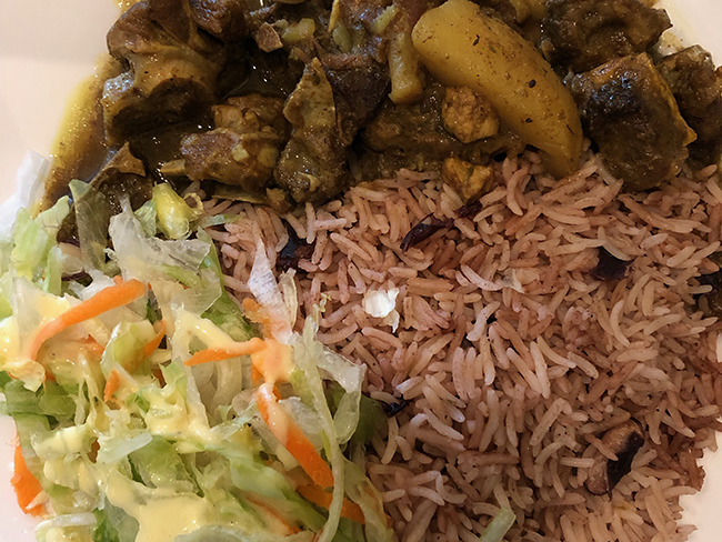 Curry goat with rice